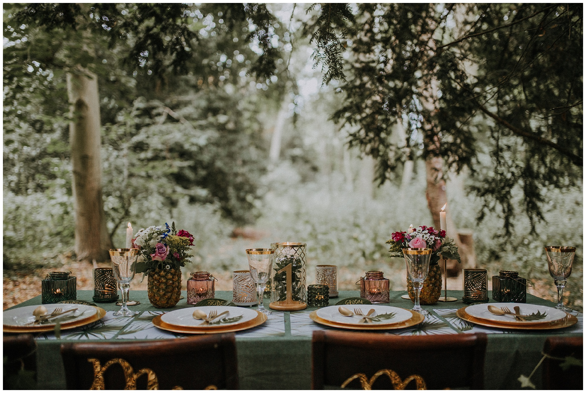 a wedding table setup in the woods