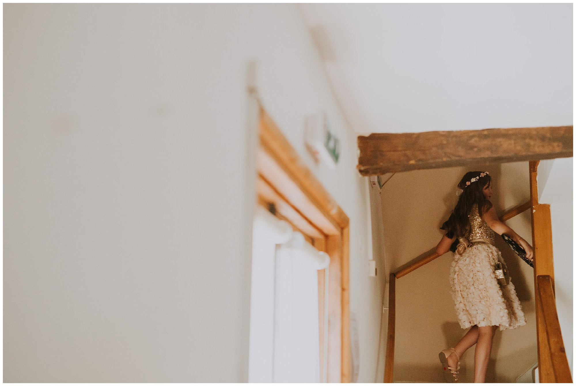 bridesmaid climbs the stairs
