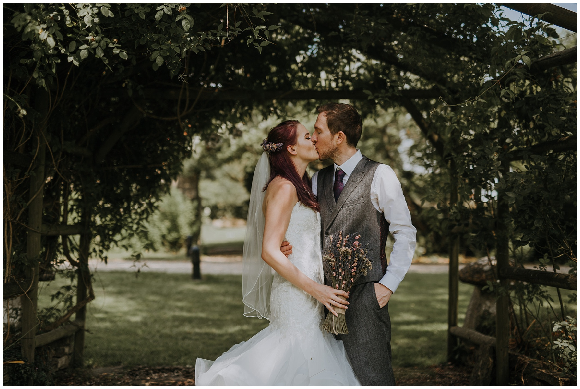couple kiss during their portraits