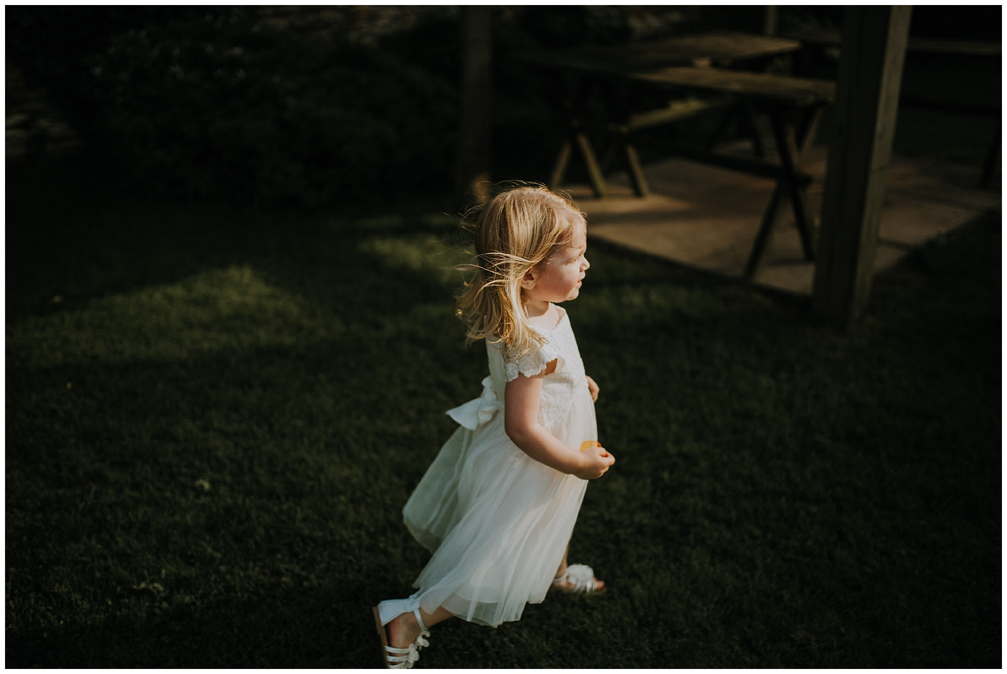 little flower girl runs through the garden
