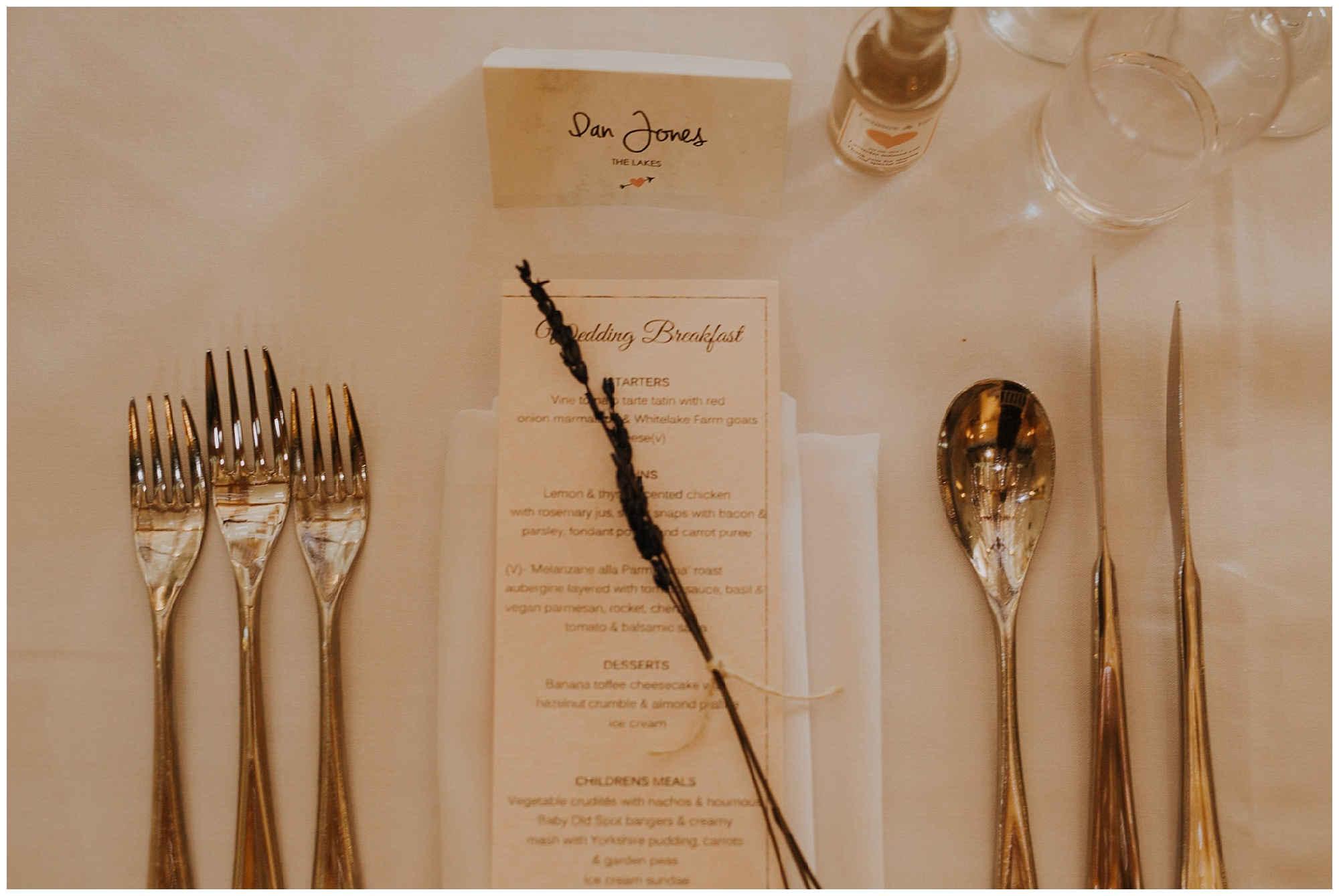 a menu and wedding place setting