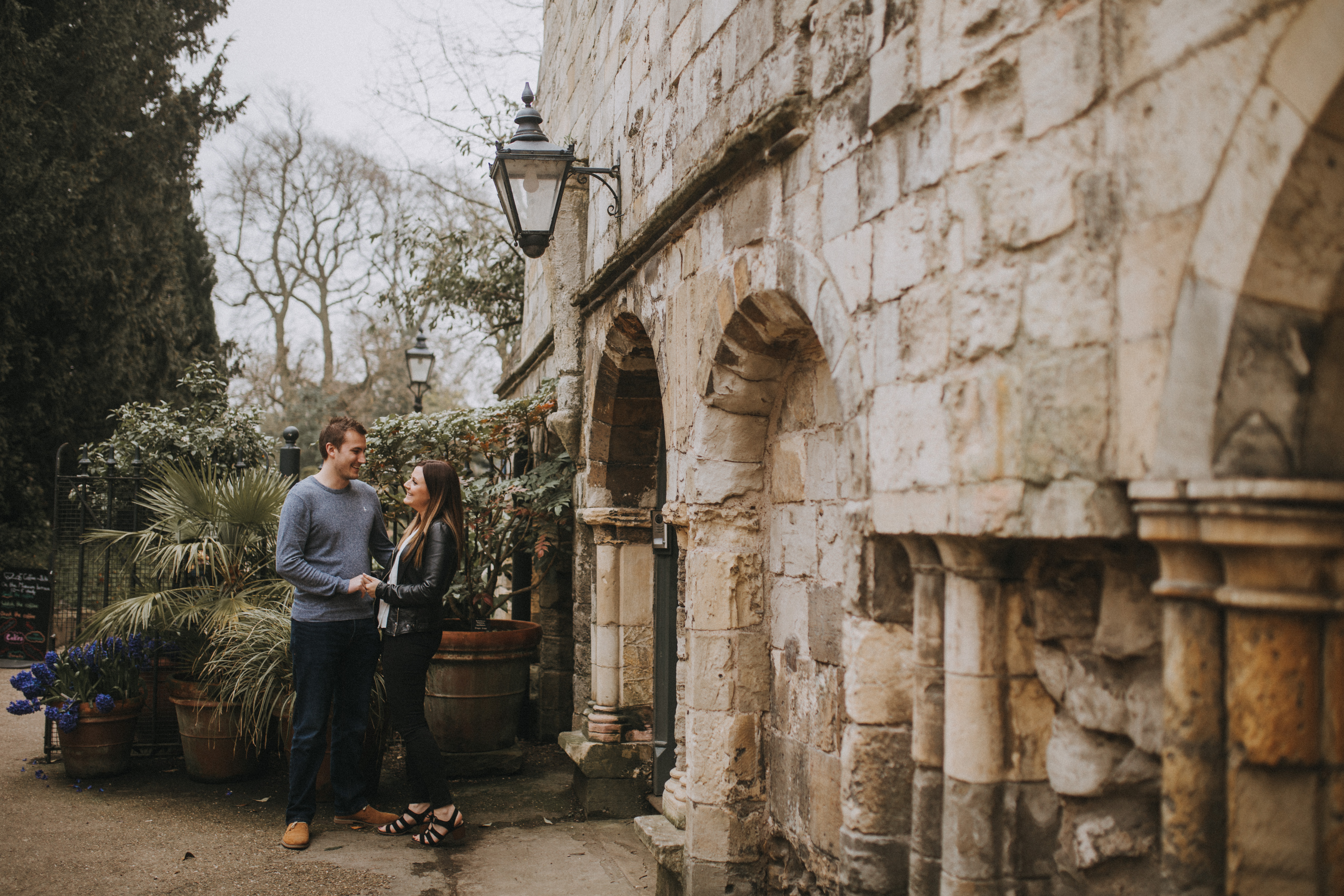 a couple in front of stone archway In York