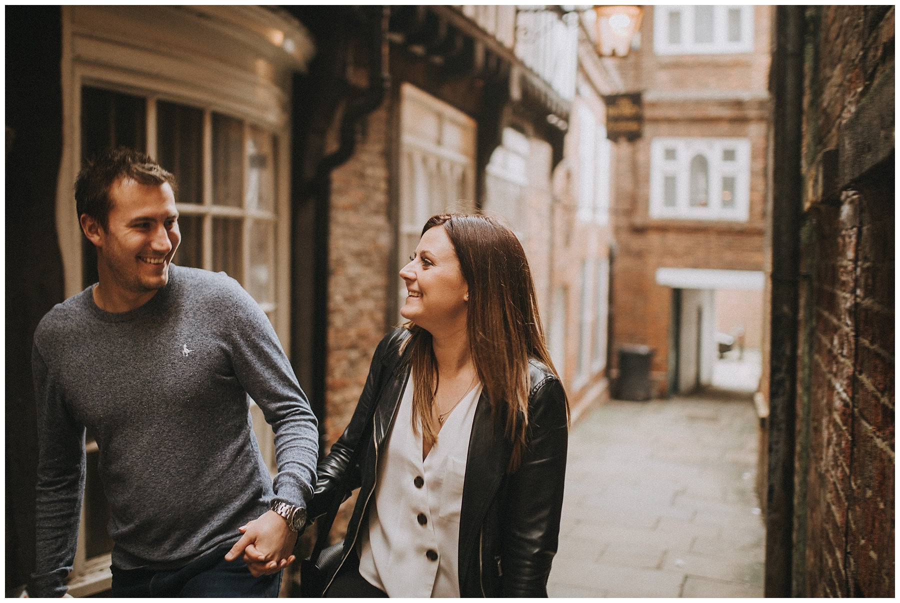 a couple wander down York's alleyways