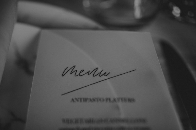 close up of a menu in black and white