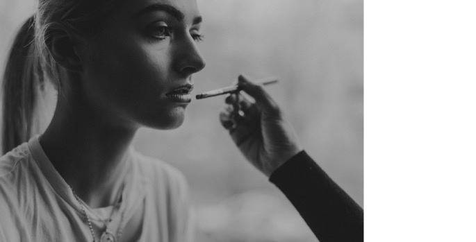 closeup of lipstick going on