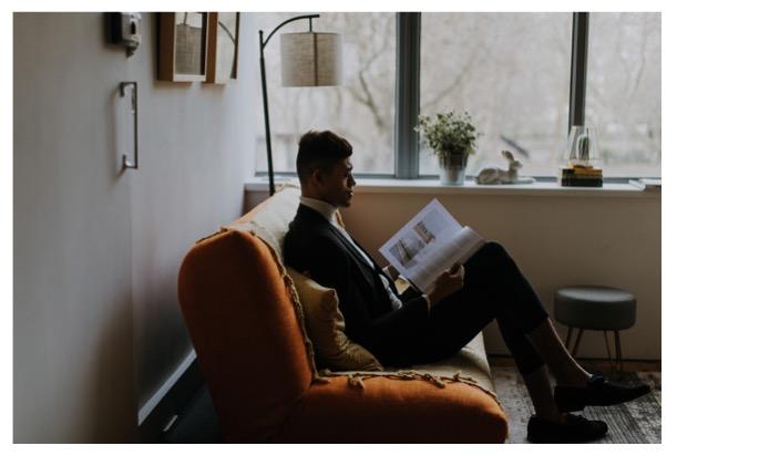 groom reads a magazine