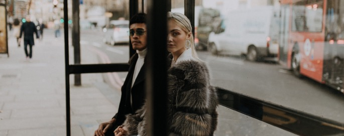 two lovers sat in a bus stop