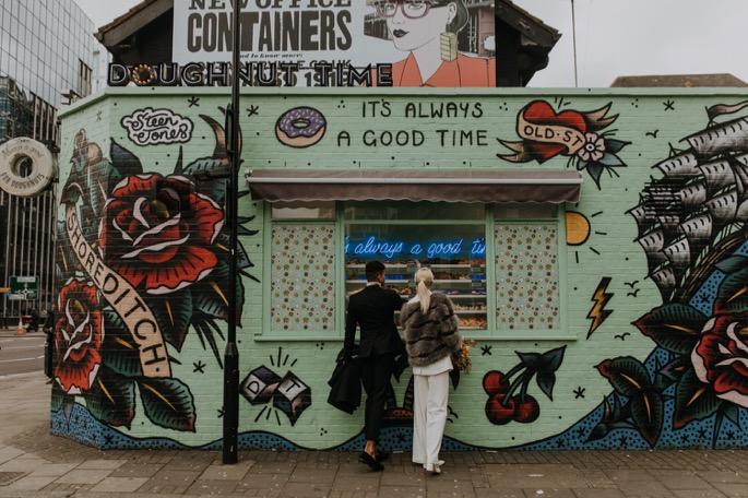 lovers outside a doughnut shop