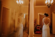 a bride's reflection in glass