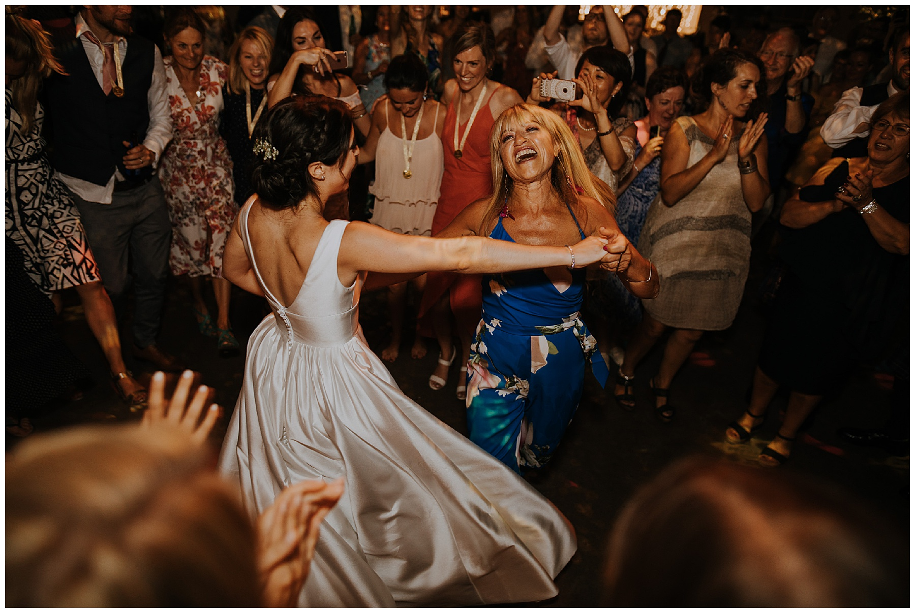 a bride dances with her mother