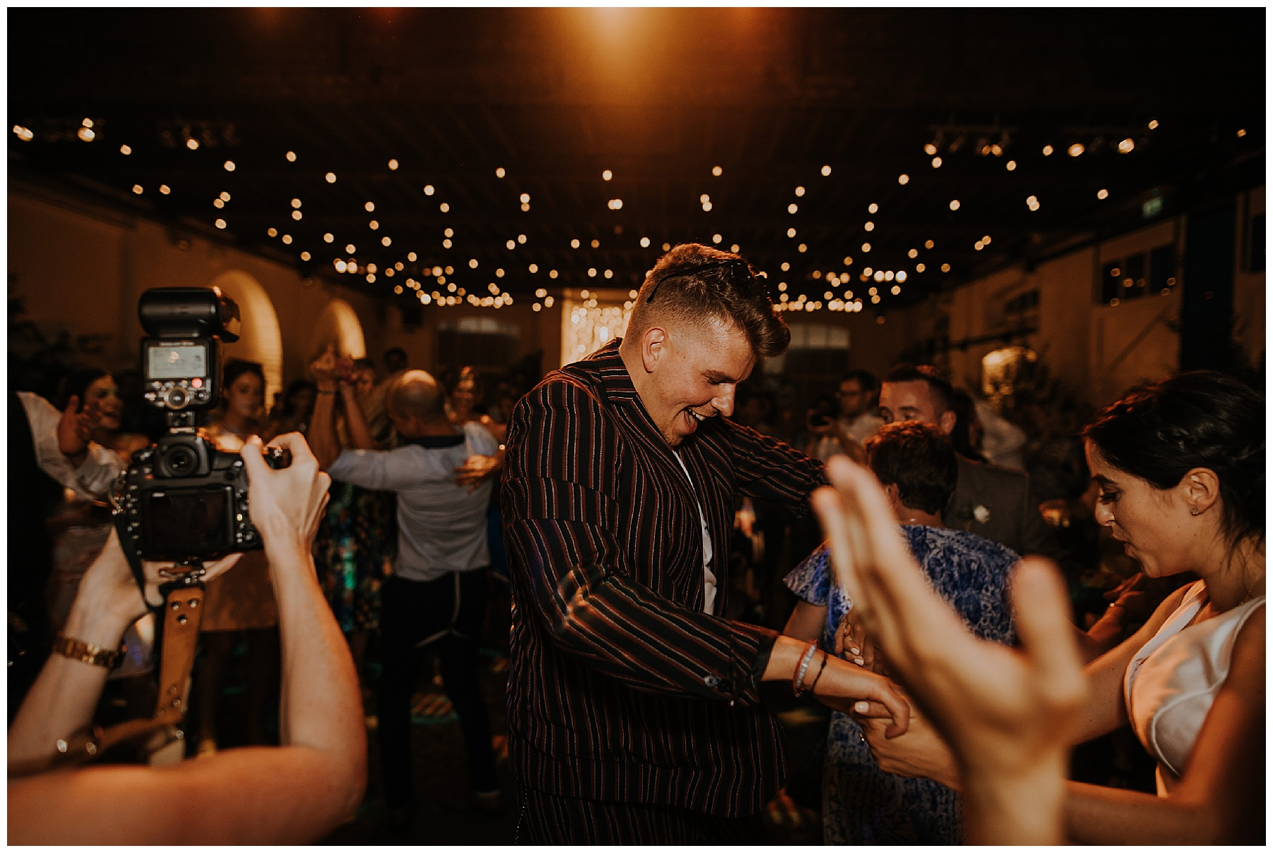 guests at a wedding dance together