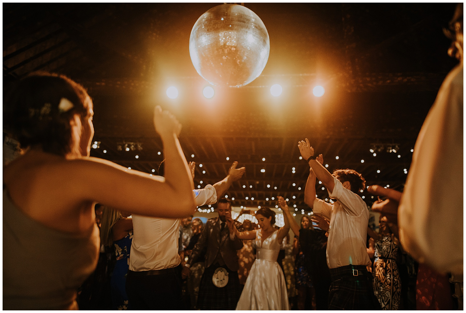 everyone dances under a disco ball