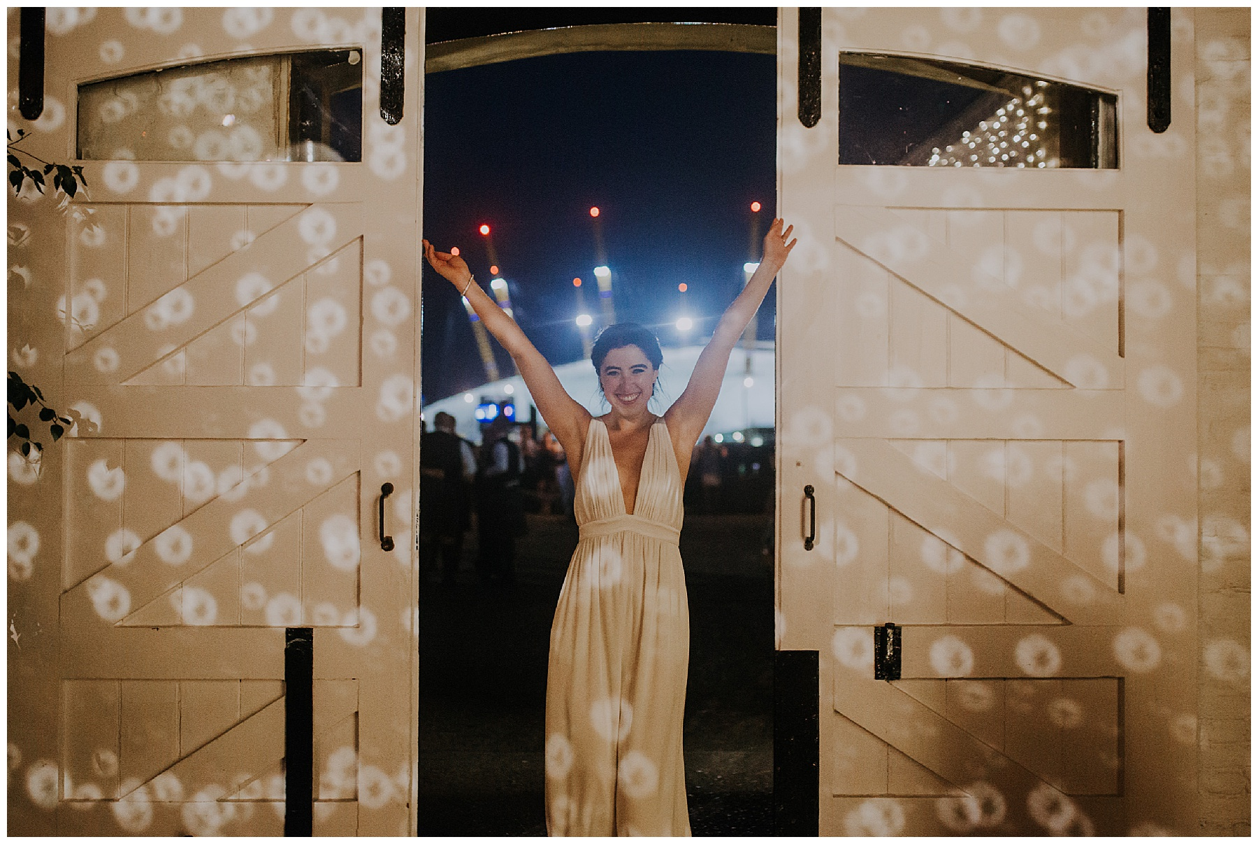 a bride in a jumpsuit in a doorway