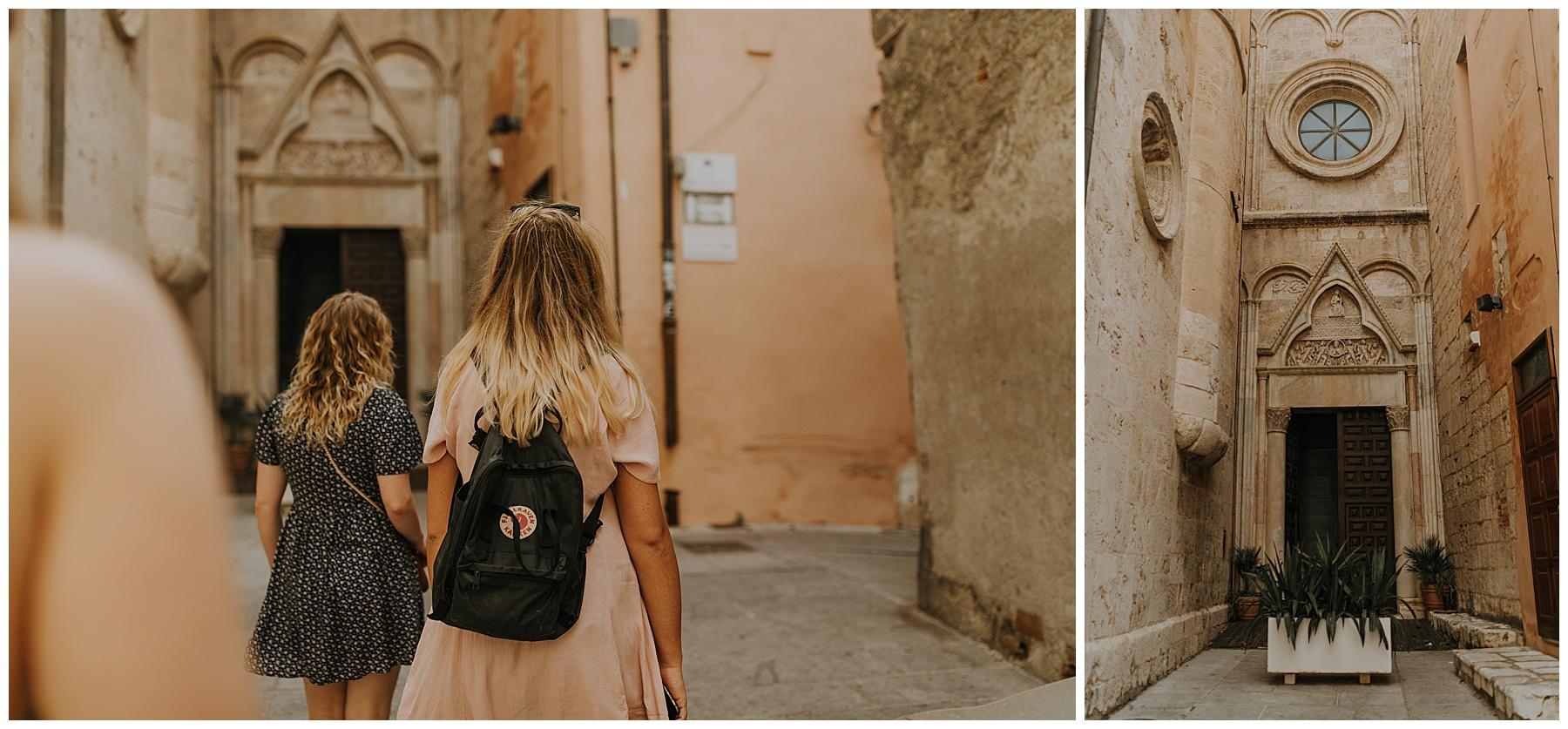 girls walk down a street