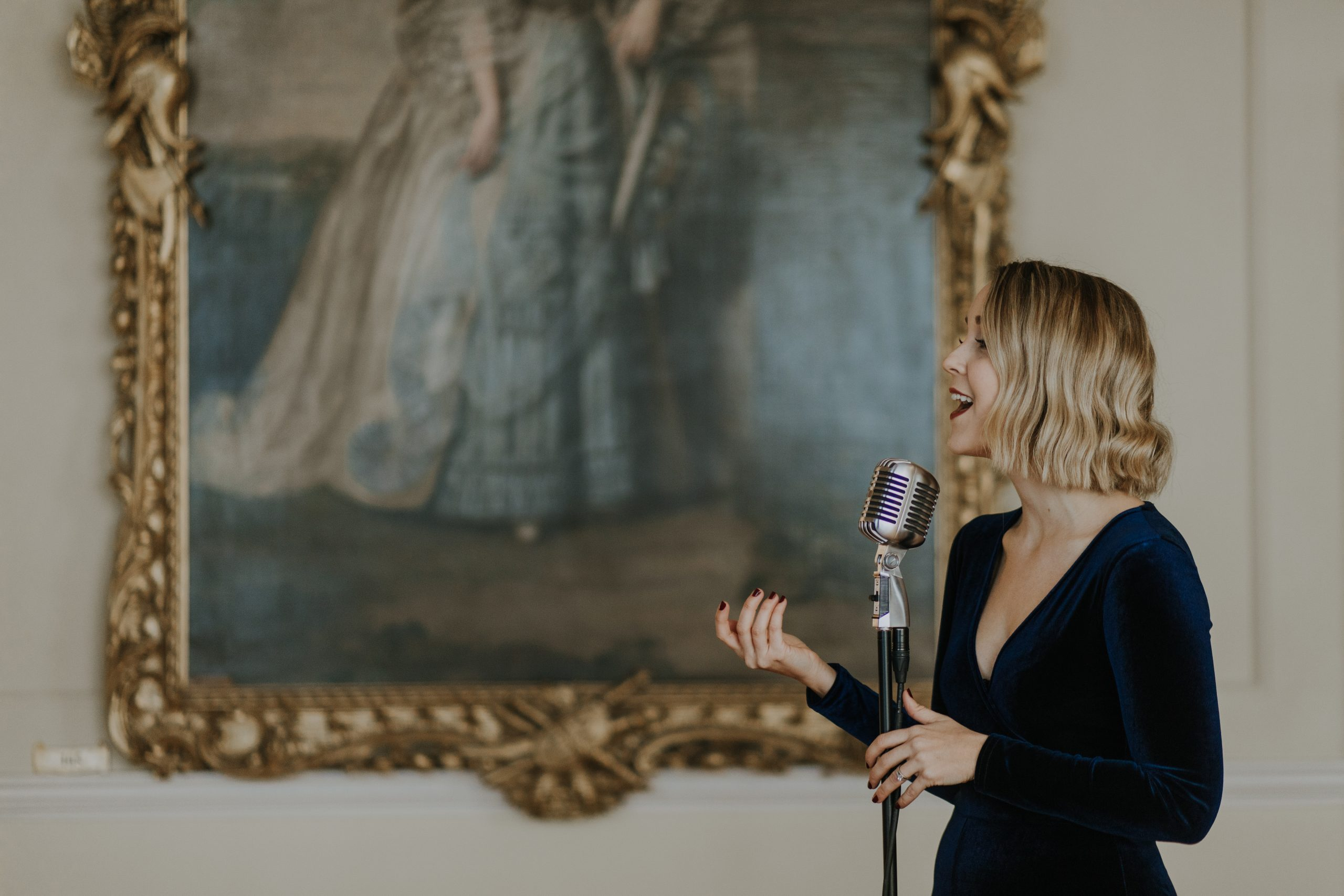 a jazz singer in front of an oil painting